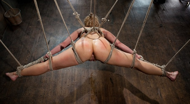 hanging woman on ropes ready for anal