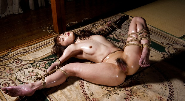 sexy asian babe roped in shibari rope on carpet